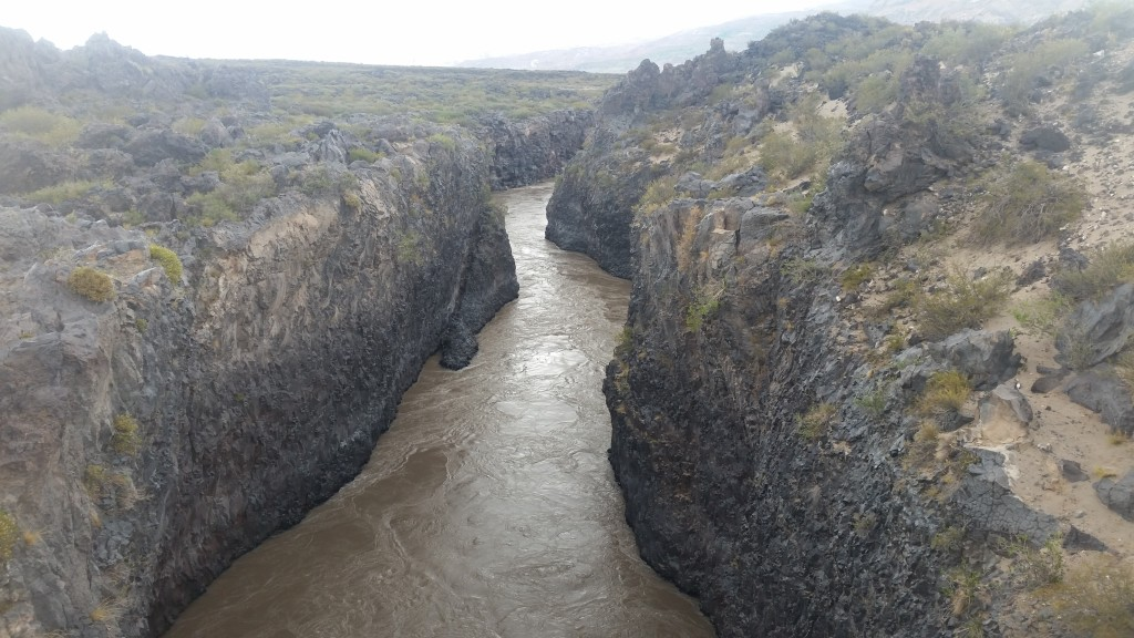 The sprawling Rio Grande hits a lava flow and cuts its way through.
