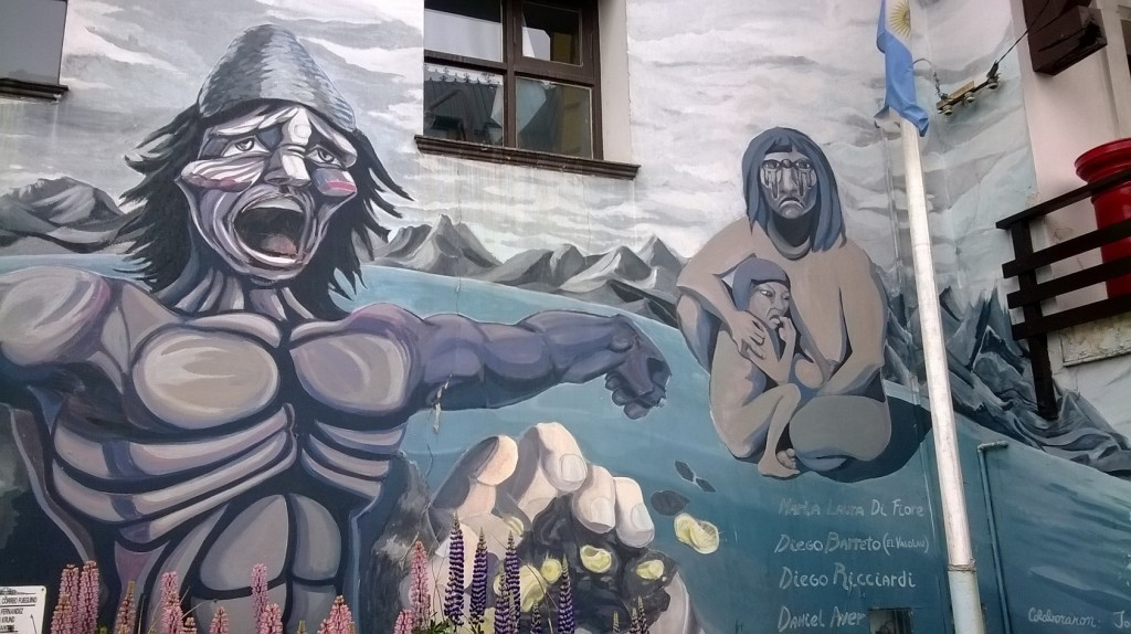 Native inhabitants depicted in a street mural in Ushuaia.
