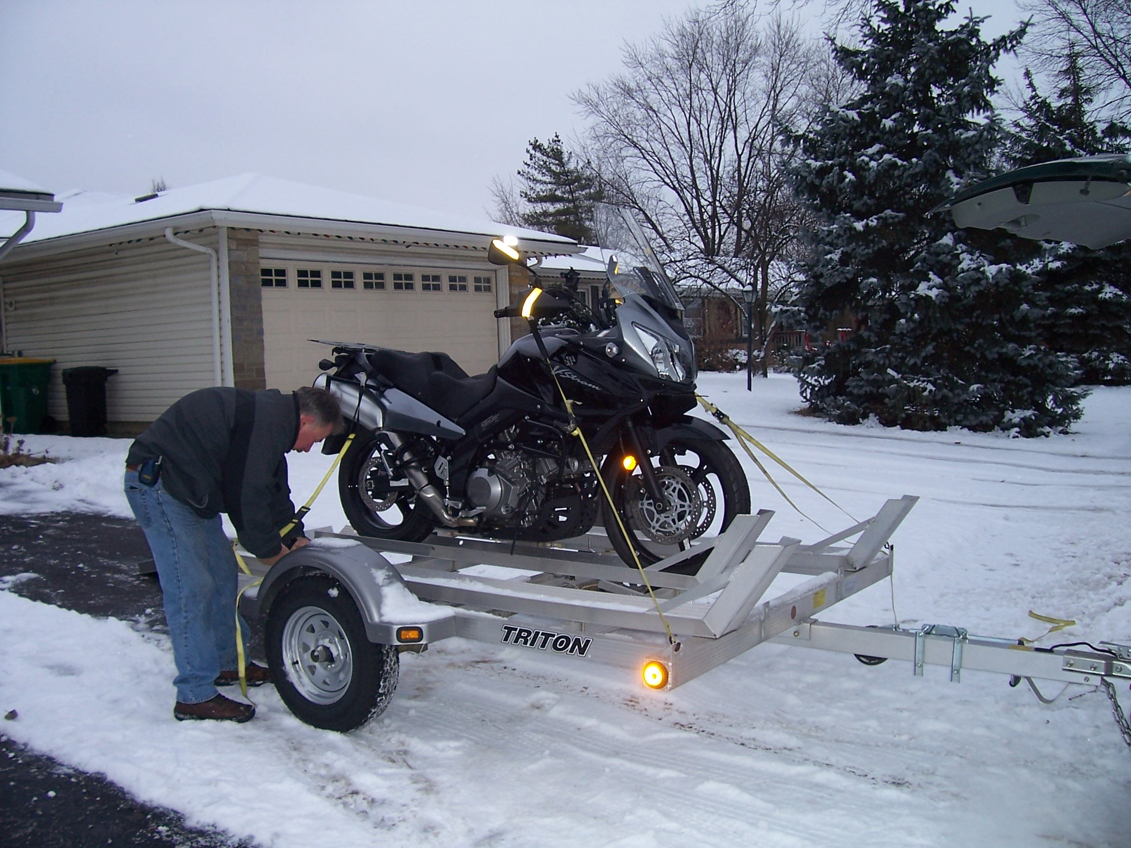 Loading up to get out of the snow.